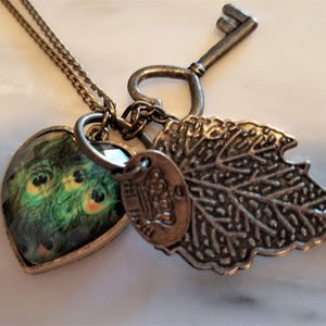 Jewelry - NWOT Peacock Key Charm Necklace